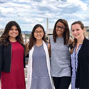 Four women outside posing