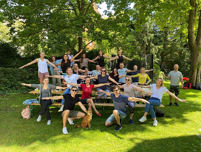 A group of female and male Ketchum Vienna colleagues on picnic table outside