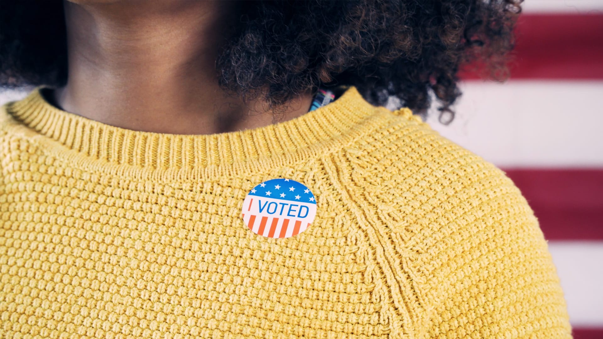 Image of sweater with I Voted sticker.