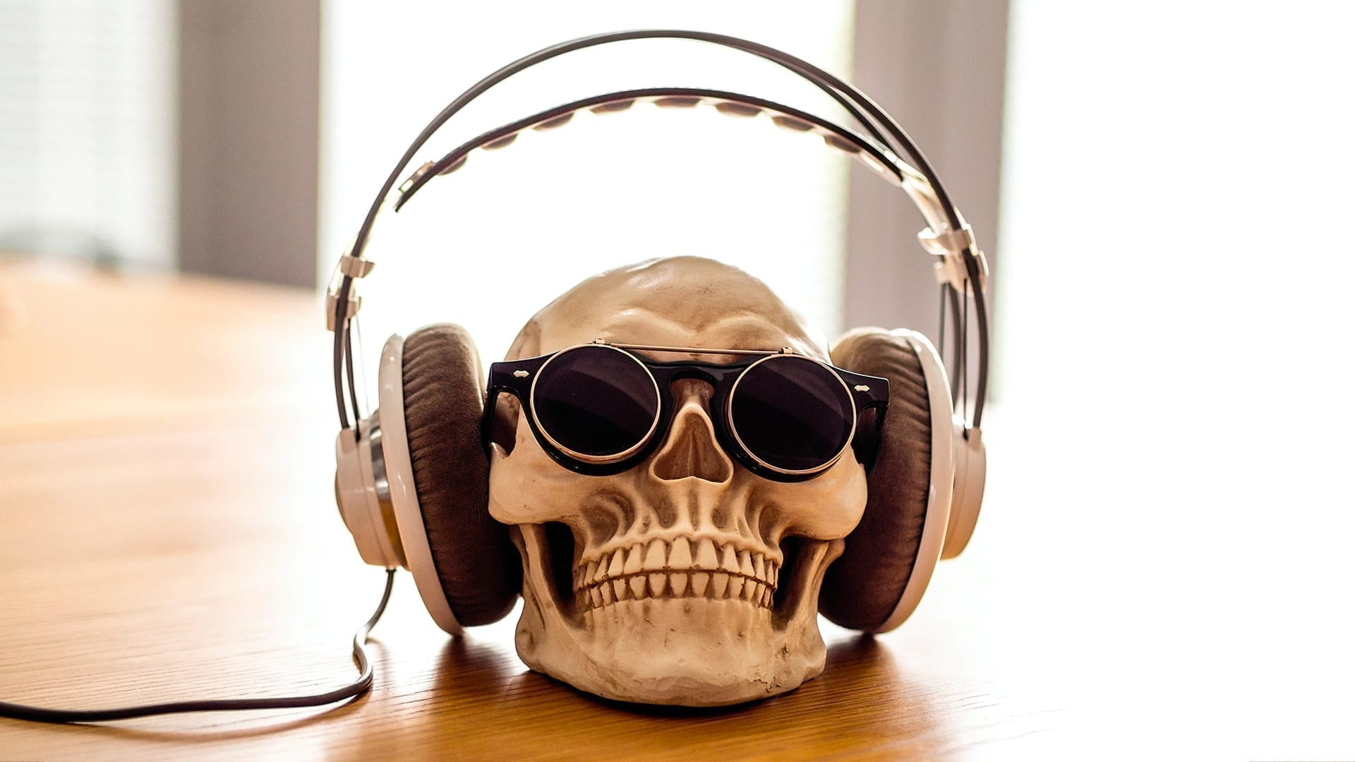 How Listening to Murder Podcasts Helps with Storytelling - photo of a skull wearing headphones