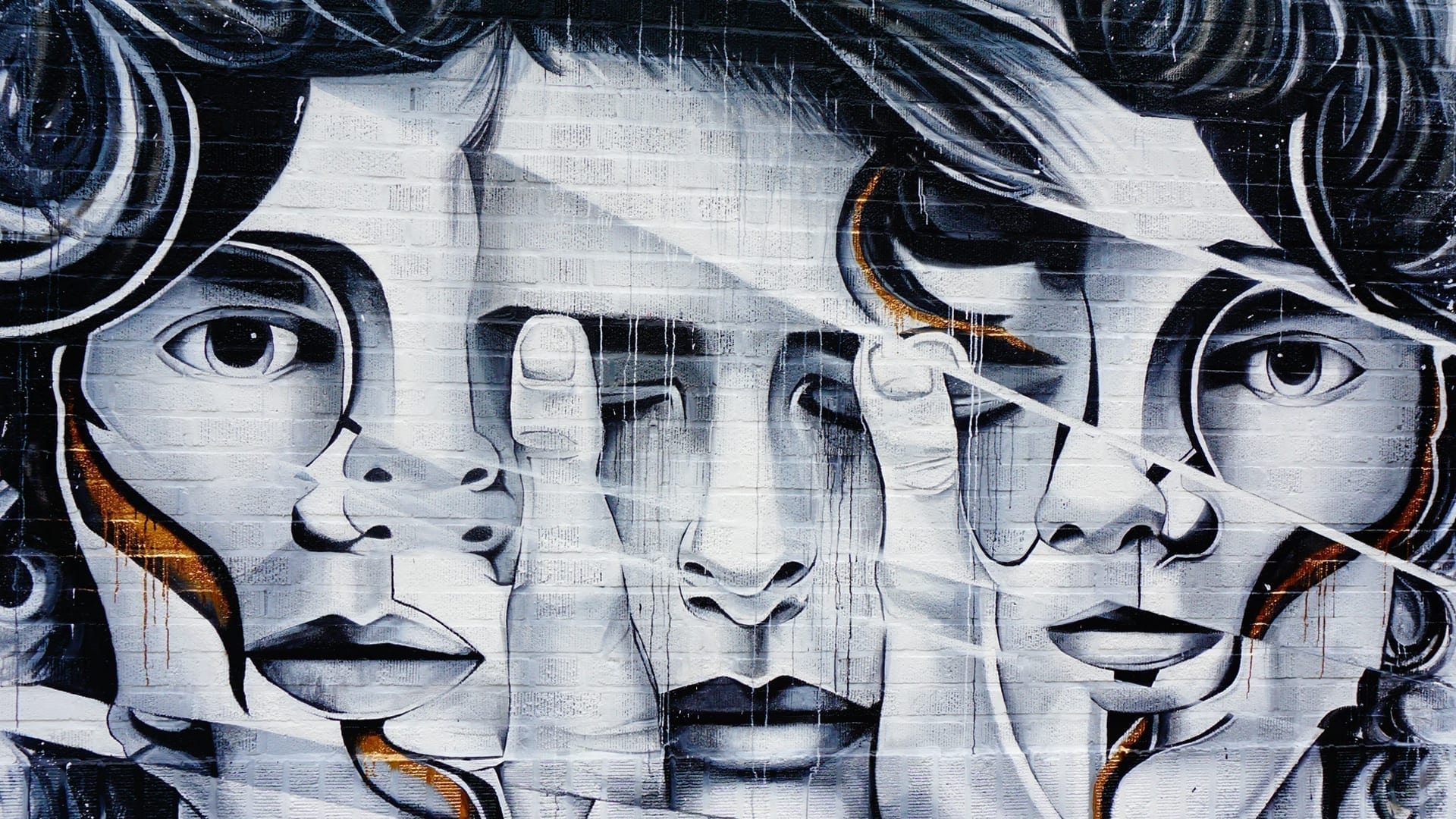 Letting Go of Imposter Syndrome - abstract street art painting of faces